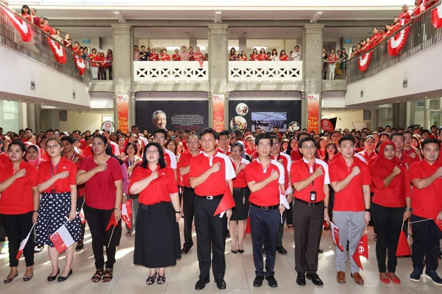 Minister Chan Chun Sing leading the recitation of the pledge during a National Day Observance ceremony at the People's Asscociation HQ.