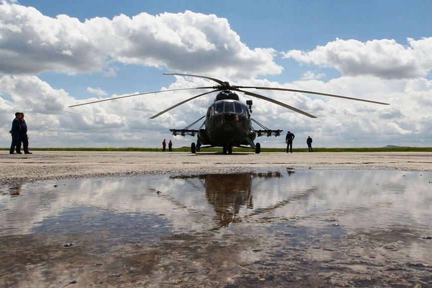 A Russian Mi-8 helicopter is seen before a flight at the airport of Karaganda, Kazakhstan, on June 18, 2016.