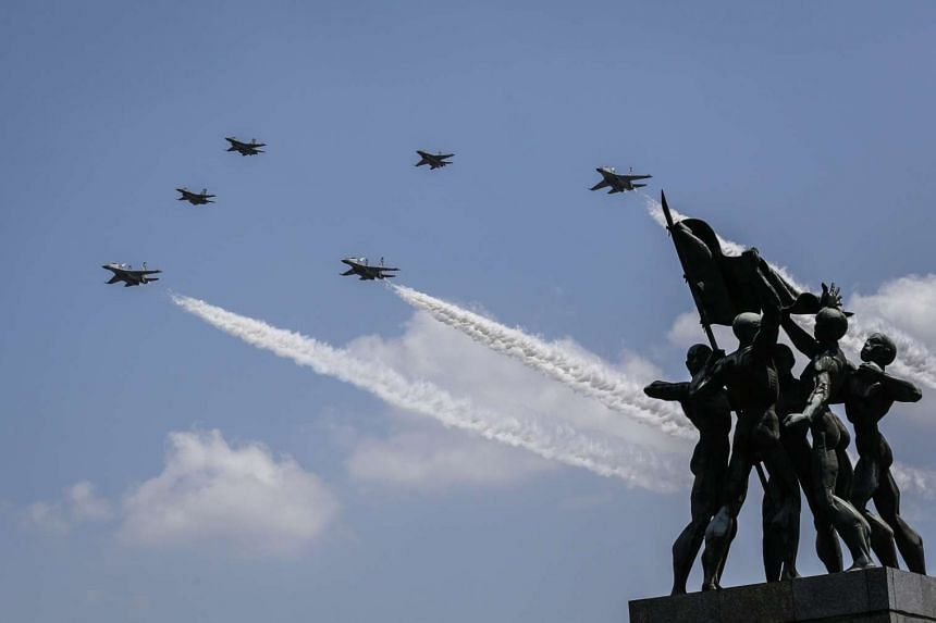 Indonesian Air Force jets fly past the Ikada statue to mark the country's 71st anniversary of independence, in Jakarta on Aug 17, 2016.