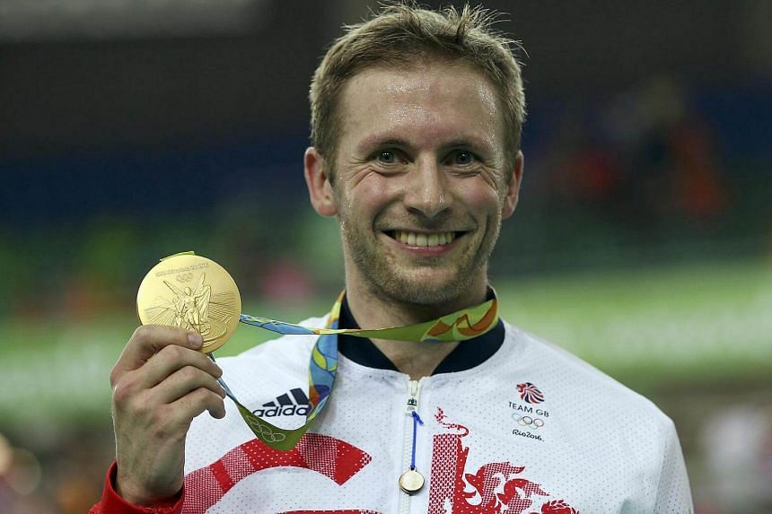 Jason Kenny (GBR) of Britain poses with the gold medal.