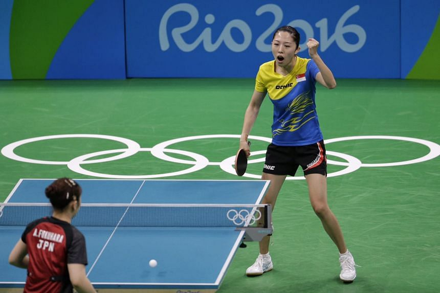 Yu Mengyu of Singapore in action against Japan's Ai Fukuhara.