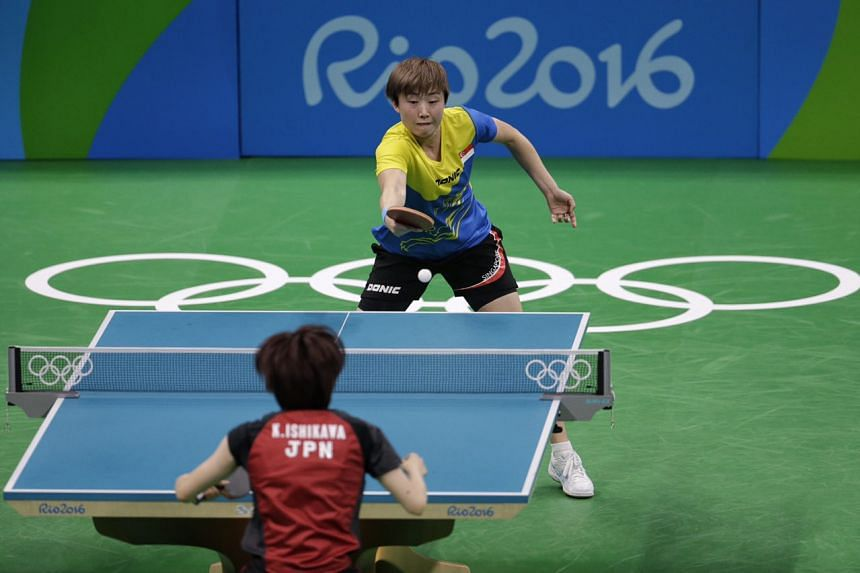 Feng Tianwei of Singapore in action against Japan's Kasumi Ishikawa.