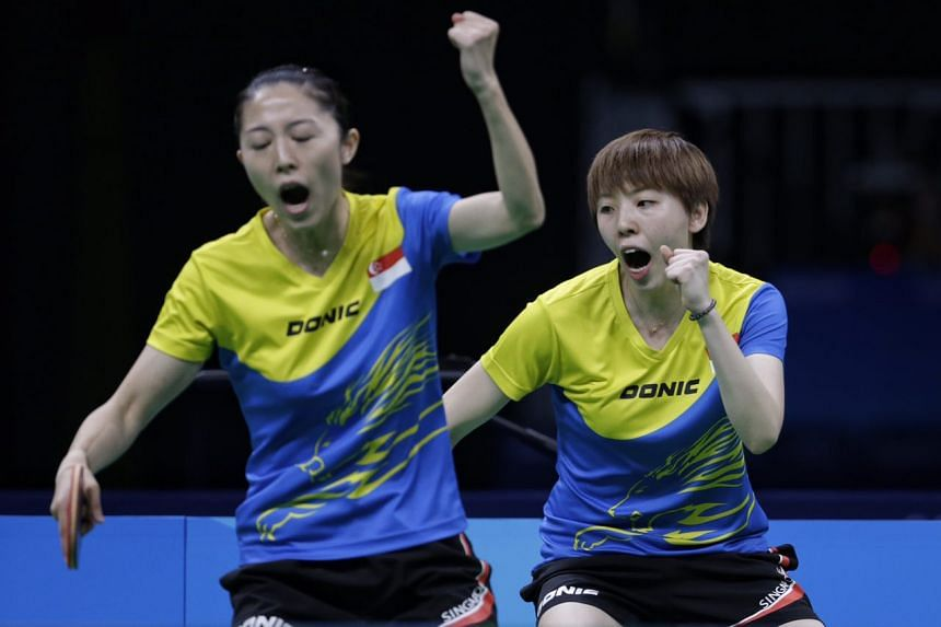 Yu Mengyu and Feng Tianwei in action during the play-off for bronze.