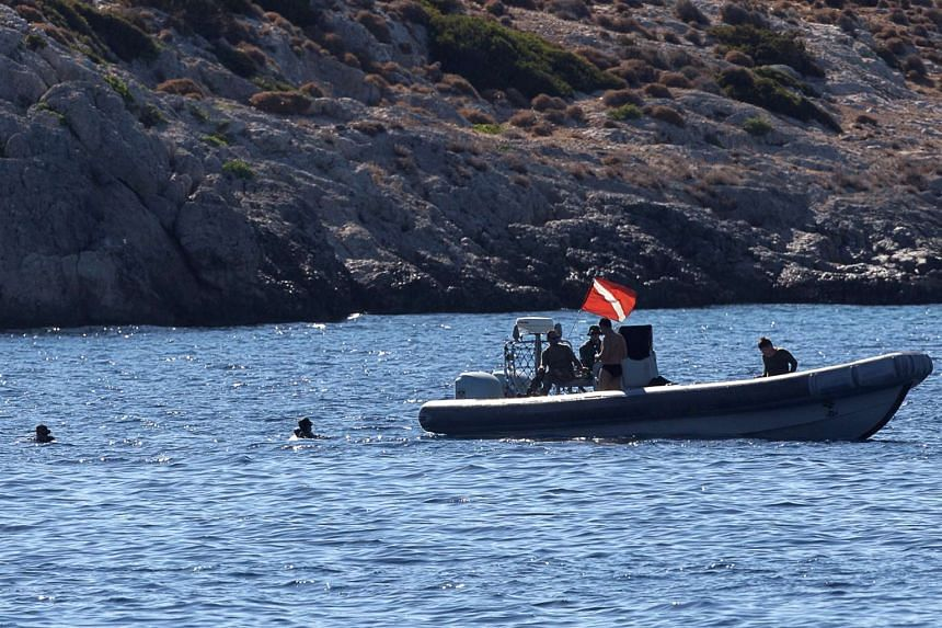 Greek authorities inspect the area where four people, including a nine-year-old girl, died.