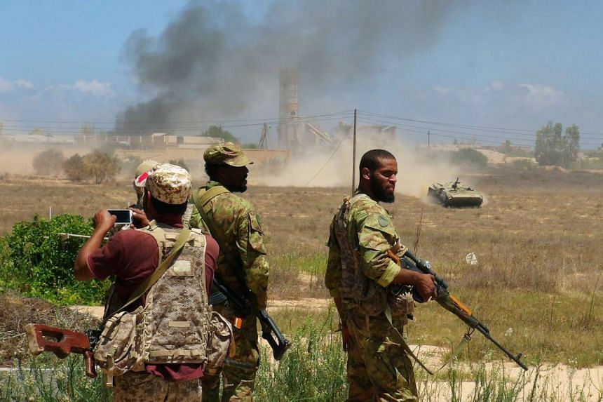 Libyan forces allied with the UN-backed government prepare to capture university buildings during a battle with ISIS fighters in Sirte on Aug 10, 2016.