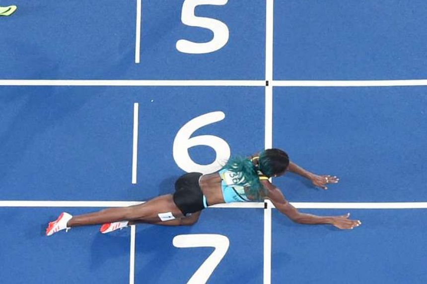 Shaunae Miller dives to cross the finish line, winning the 400m by just .07sec ahead of American favourite Allyson Felix on Monday. It was the Bahamas' first track and field gold medal of the meet, but Felix was left distraught after the narrow defeat.