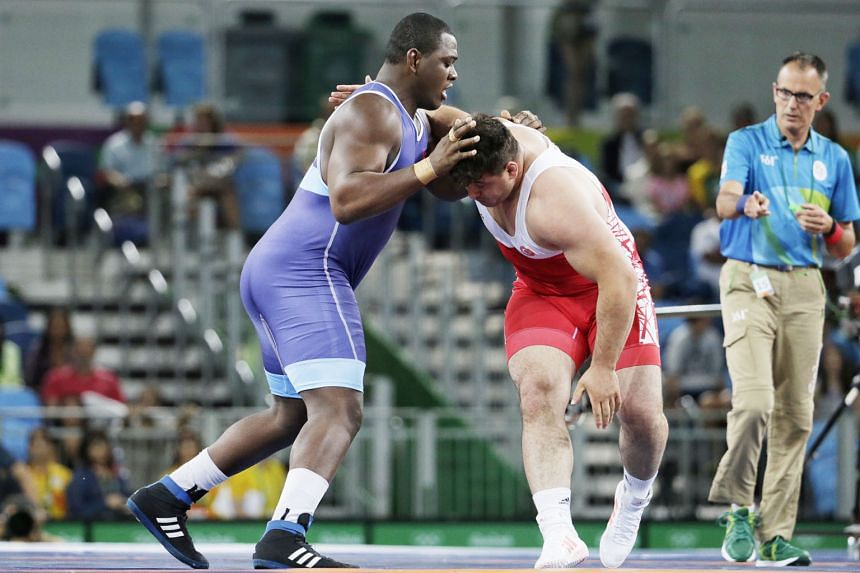 Who said big men can't dance? Mijain Lopez of Cuba, who weighs 130kg, performing an impromptu series of dance moves after defeating arch-rival Riza Kayaalp of Turkey 6-0 in the Greco-Roman super- heavyweight event on Monday