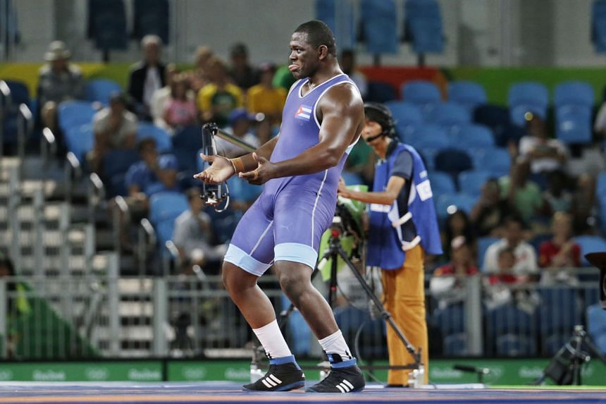 Who said big men can't dance? Mijain Lopez of Cuba, who weighs 130kg, performing an impromptu series of dance moves after defeating arch-rival Riza Kayaalp of Turkey 6-0 in the Greco-Roman super- heavyweight event on Monday.
