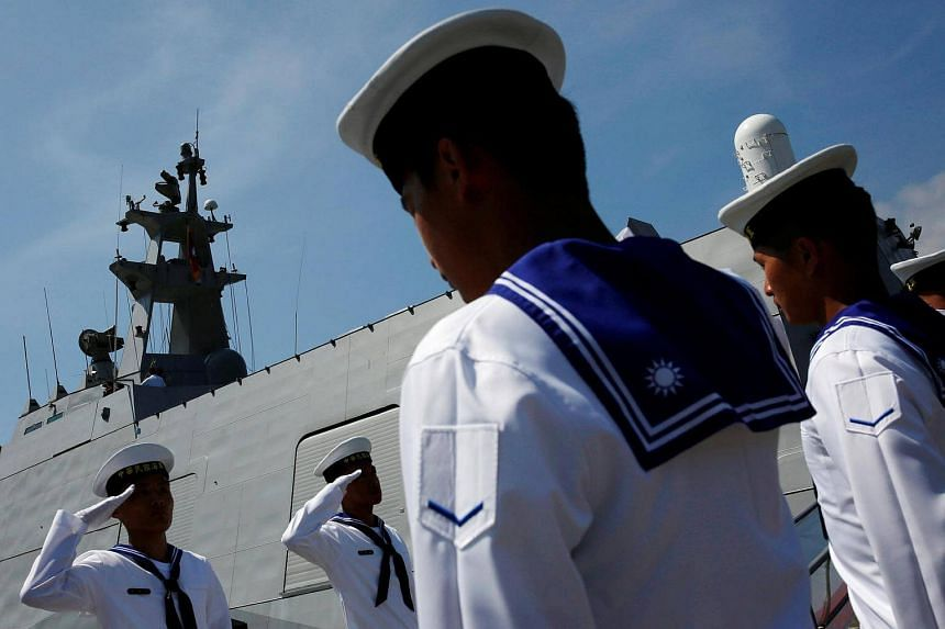 Taiwanese navy soldiers salute as President Tsai Ing-wen (not pictured) boards the nation's first domestically built stealth-missile 600-ton Tuo Jiang twin-hull corvette at Suao Naval Base in Yilan, Taiwan on June 4.