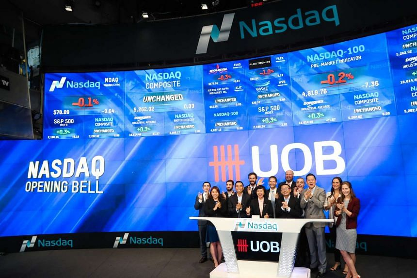 Senior management from UOB's Commercial Banking team and senior executives from OurCrowd at the Nasdaq opening bell ceremony as part of a visit to further its investments into financial technology firms.