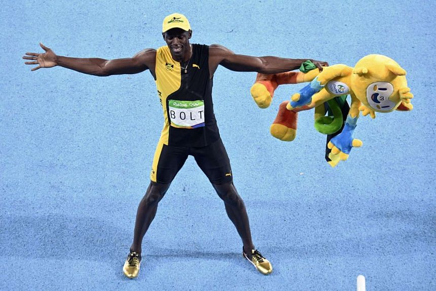 Jamaica's Usain Bolt celebrates after winning the Men's 100m Final at Olympic Stadium in Rio de Janeiro on Aug 14.