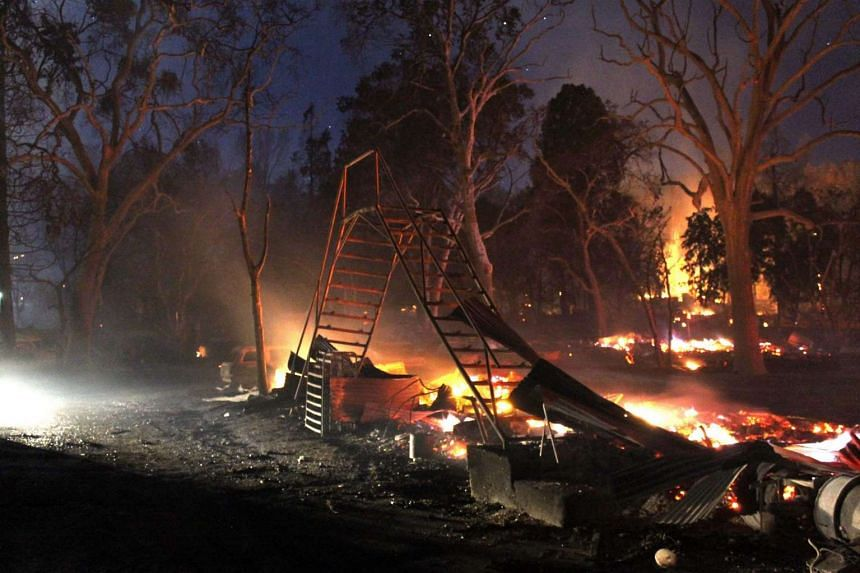 Remains of a structure on Main St. as the Clayton Fire affected Lower Lake, in Lake County, northern California, USA on August 14.