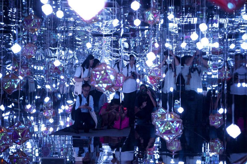 Members of the media are reflected in mirrors during the Singapore Night Festival media preview on Aug 17, 2016.