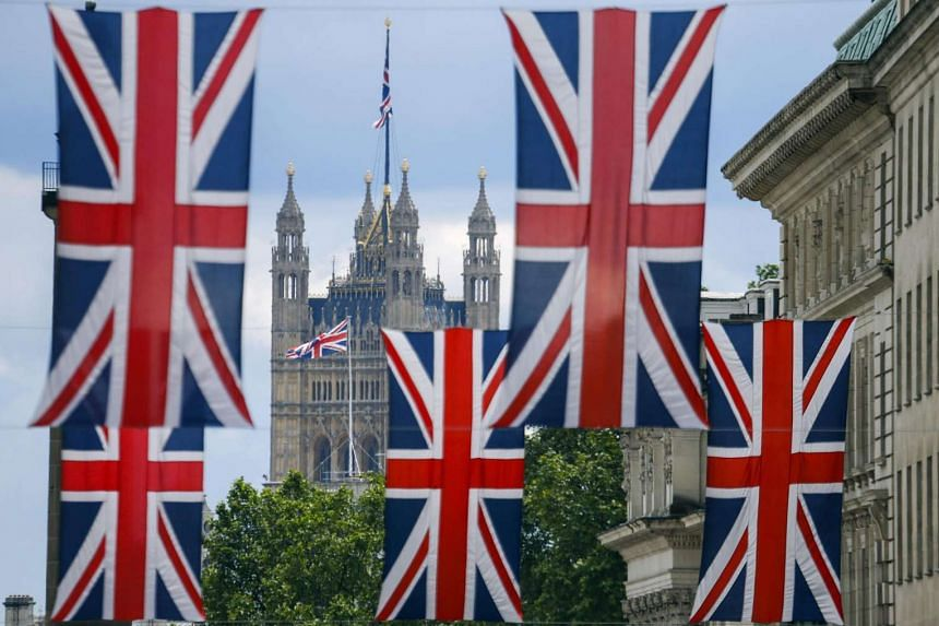 Union flag banners hang across a street near the Houses of Parliament in central London on June 25.