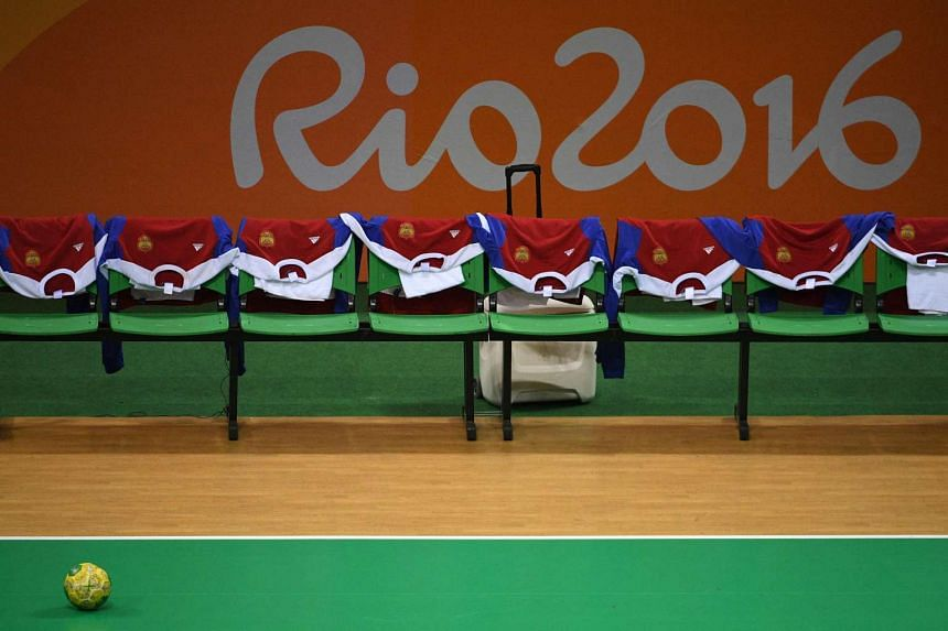 The jerseys of the Russian teams are displayed on the bench past the logo of Rio 2016 at the Future Arena in Rio on August 14.