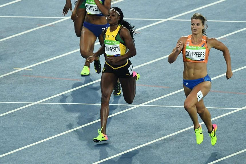 Jamaica's Elaine Thompson (left) and Netherlands' Dafne Schippers (right) compete in the Women's 200m semi-finalat the Olympic Stadium in Rio de Janeiro on August 16.