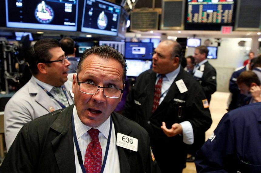 Traders work on the floor of the New York Stock Exchange on Aug 17, 2016.