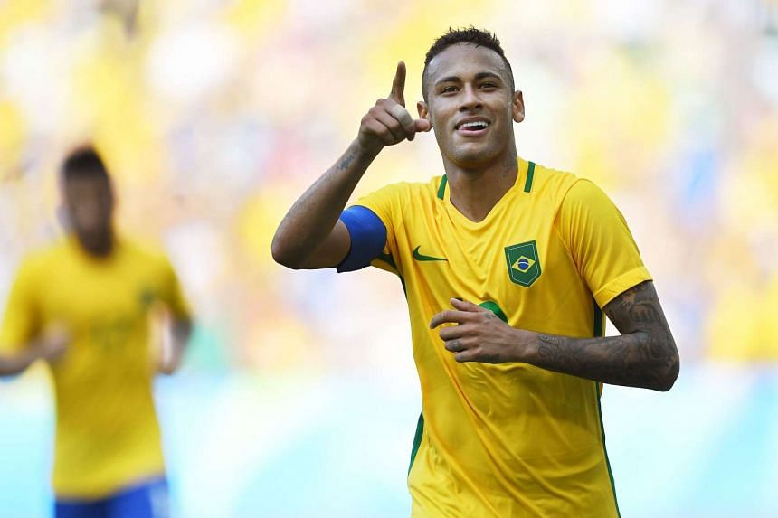 Brazil's Neymar celebrates after scoring a penalty against Honduras during their Rio 2016 Olympic Games men's football semi-final match