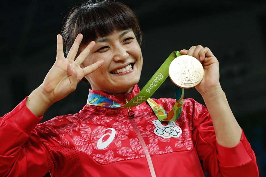 Japan's Kaori Icho celebrates on the podium after winning after winning in the women's 58kg freestyle wrestling event on August 17.