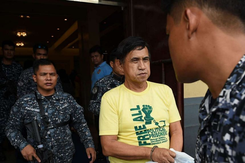 Adelberto Silva, is escorted by armed jail guards as he arrives for his bail hearing at a court in Manila on Aug 11, 2016.