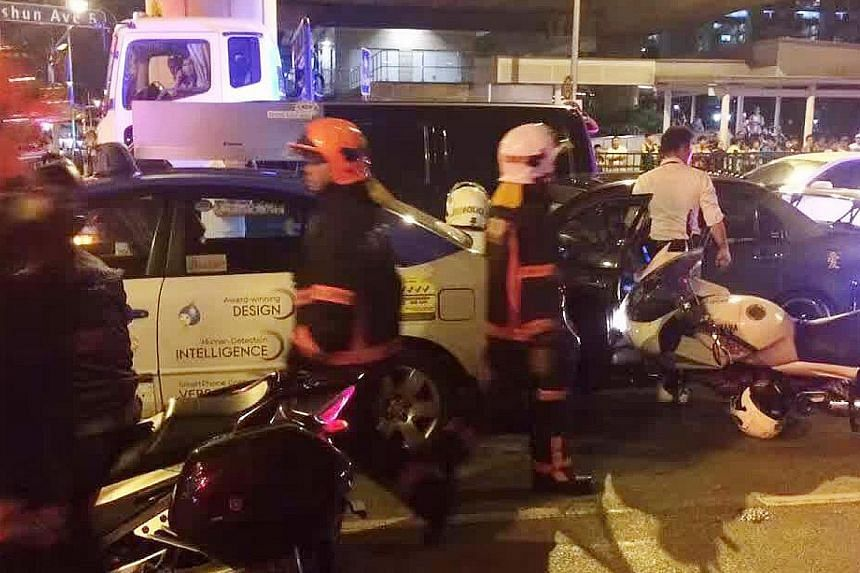 SCDF and police at the scene of the accident (left and below, left) on Tuesday night. The 28-year-old driver put up a struggle and tried to evade arrest. Two police officers were injured in the scuffle. The man was later arrested for drug and traffic