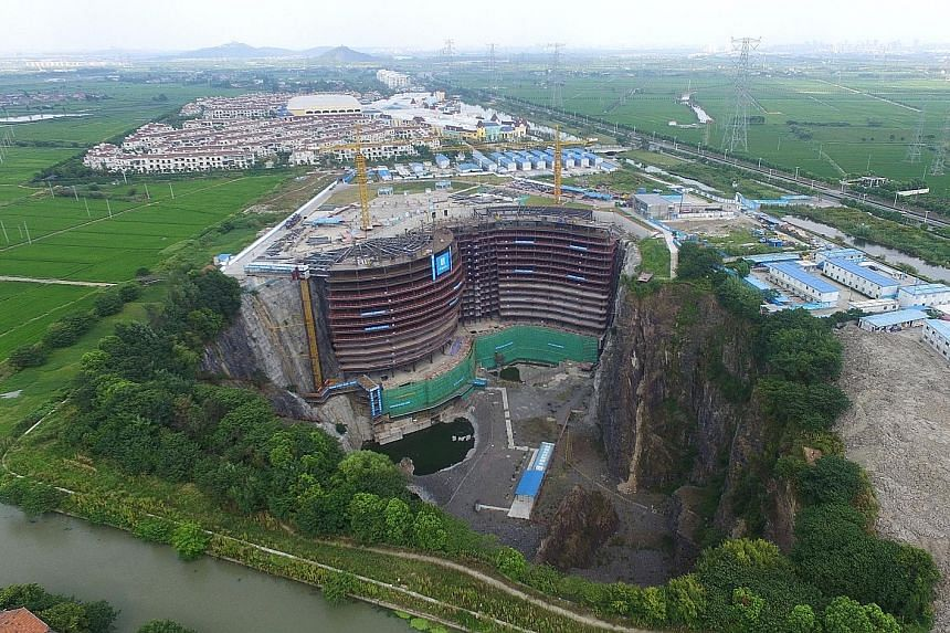The construction site of the Shimao quarry hotel in the Songjiang district of Shanghai in east China. The five-star hotel is being built in a disused, 90m-deep quarry. Estimated to be completed next year, the hotel will have 370 guest rooms in its tw