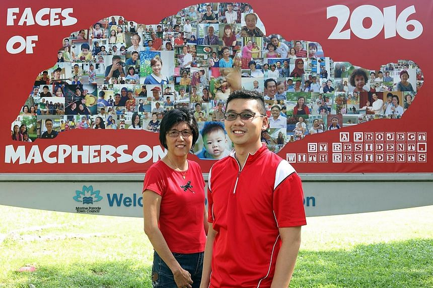 """MacPherson residents Madam Tan and Mr Chan before the """"Faces of MacPherson"""" billboard in Geylang East Central Road, a montage of photos taken by Mr Chan and six other photographers. The project was started in February and officially launched on July"""
