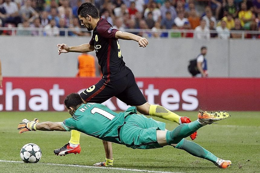 Man City's new signing Nolito going round Steaua Bucharest goalkeeper Florin Nita to score their third goal in their 5-0 Champions League rout.