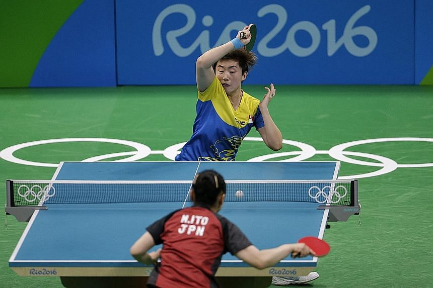 Team captain Feng Tianwei netting a forehand during her 9-11, 4-11, 6-11 loss to Japan's 15-year-old Mima Ito during the women's team bronze medal play-off on Tuesday.