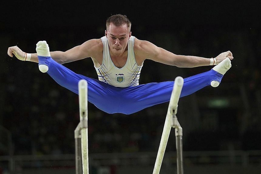 Top: Oleg Verniaiev's victory on the parallel bars was Ukraine's first gold medal of these Games. Germany's Fabian Hambuchen wins the horizontal bar title after finishing third in Beijing and second in London.