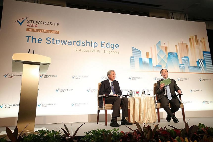 DPM Teo Chee Hean (left) at the Stewardship Asia Roundtable yesterday, with Mr Hsieh Fu Hua, the chairman of Stewardship Asia Centre, as moderator. Mr Teo said that sometimes, because government is not very effective, there is innovation because ther