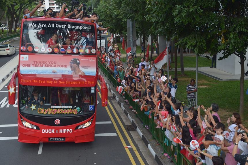 Olympic champion Joseph Schooling's victory parade gets off to a rousing start as fans lined the roads and crowd pit stop 1, Marine Terrace Market to welcome the swimmer.