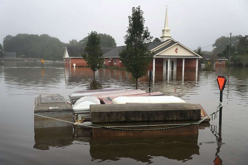 Caskets are seen floating in flood waters near a cemetery on Aug 17, 2016 in Gonzales, Louisiana.