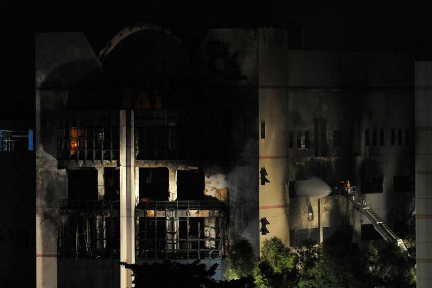 SCDF personnel still trying to put out the fire around 1am on Aug 18 ,2016.