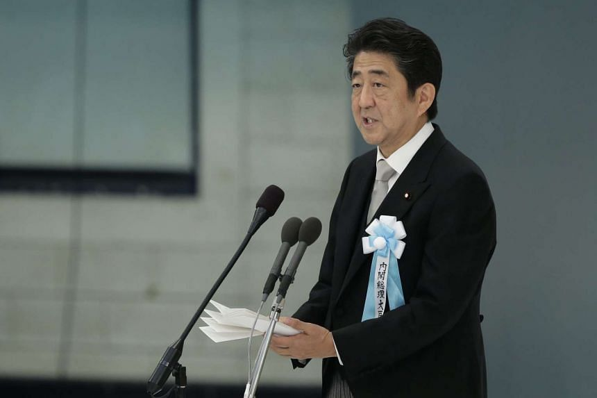 Japanese Prime Minister Shinzo Abe speaks during a memorial service at Nippon Budokan Hall in Tokyo, Japan on August 15.