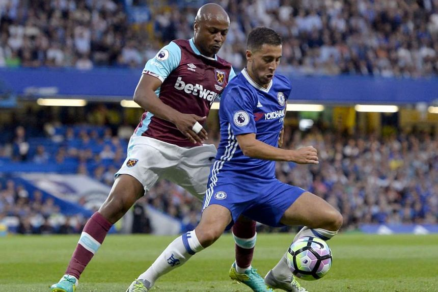 Chelsea's Eden Hazard (right) in action against West Ham United's Andre Ayew during their English Premier League soccer match on Aug 15, 2016.