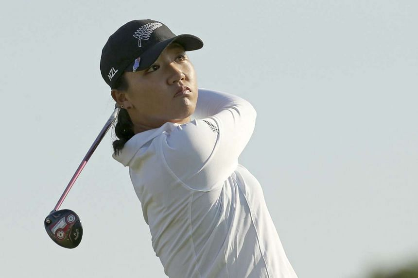 Lydia Ko of New Zealand watches her tee shot on the 16th hole during first round women's Olympic golf competition.