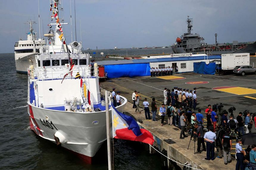 A Philippine flag flutters in front of the BRB Tubbataha, one of 10 multi-role vessel the Philippines is acquiring from Japan.