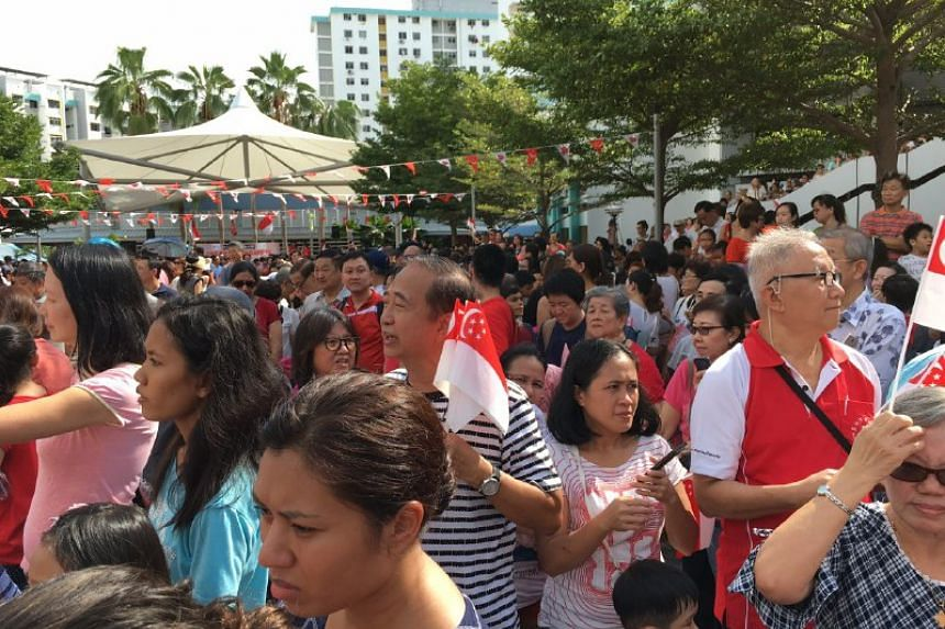 People gathered to greet Joseph Schooling as he arrives at Marine Terrace Market on Aug 18.