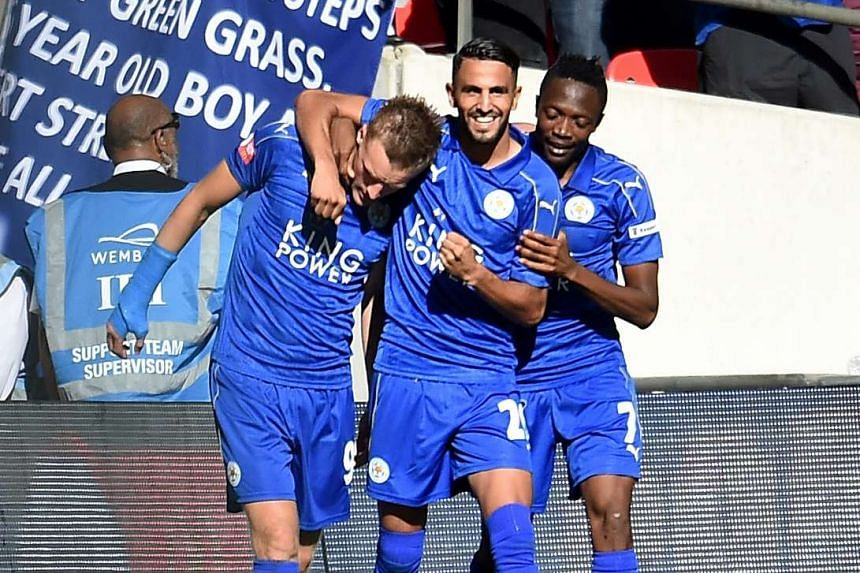 Leicester's Jamie Vardy (left) celebrates a goal with Riyad Mahrez (centre) and Ahmed Musa (right).
