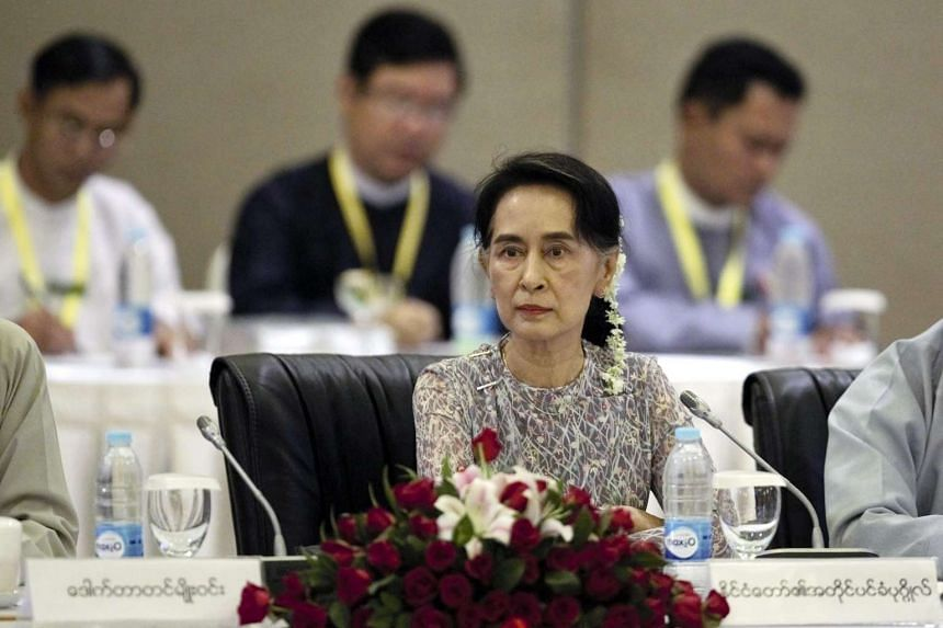 Aung San Suu Kyi looks on as she and members of the Union Peace Dialogue Joint Committee (UPDJC) attend a meeting in Naypyitaw, Myanmar on August 15.