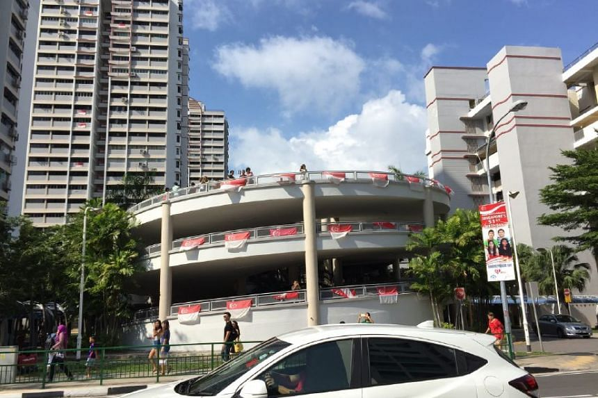 Residents opposite Marine Terrace Market waiting for Schooling with their phones at the ready on Aug 18.