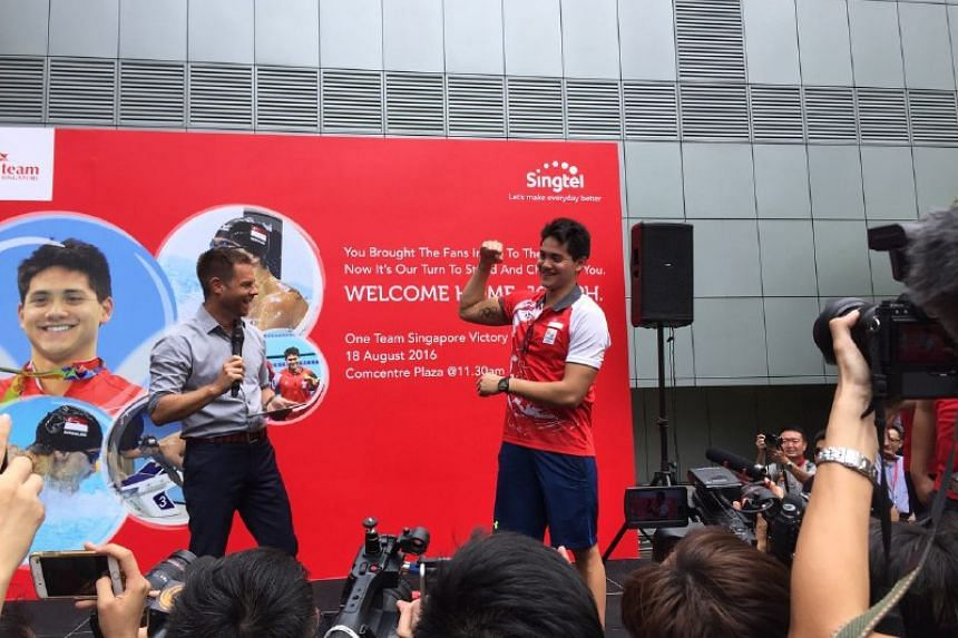 Joseph Schooling showing off his tattoo at Singtel Comcentre Plaza on Aug 18.