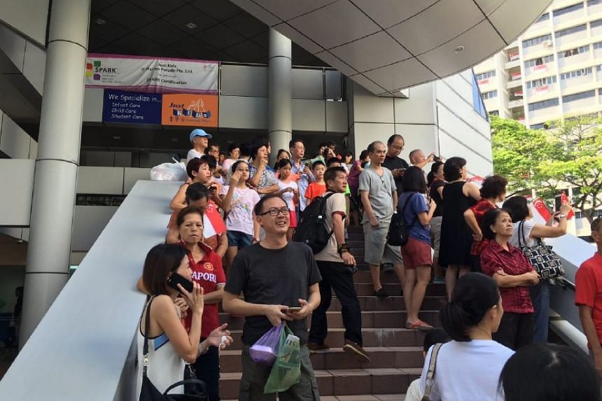 People gathering while waiting for Joseph Schooling.