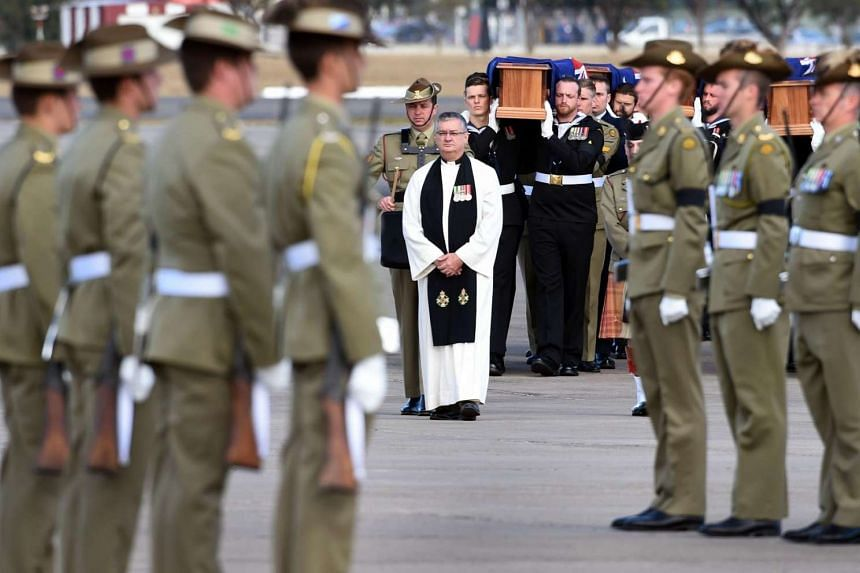 The remains of 25 Australian soldiers killed in the Vietnam War and buried in Malaysia and Singapore along with eight dependents, arrive at the Richmond Air Force base near Sydney to a full military ceremony.