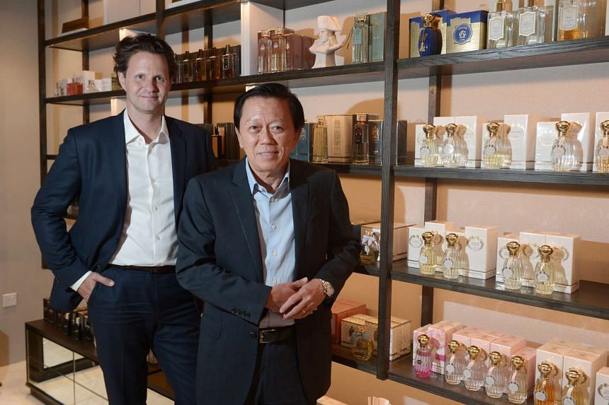 Mr Wolfgang Baier (left) takes over as Group CEO of Luxasia from company founder and chairman Patrick Chong (right).