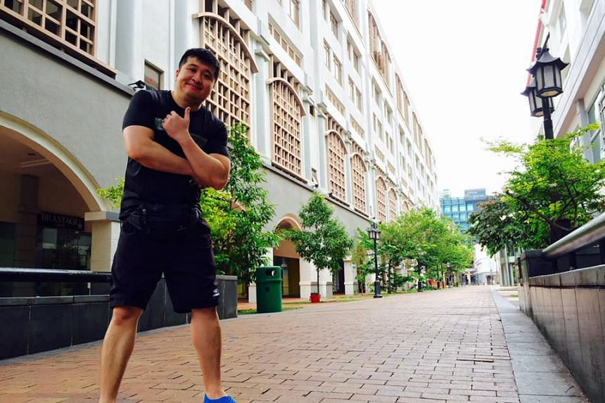 Mr Terence Ho, 39, out hunting Pokemon. He claims to be the first in Singapore to have collected all 145 Pokemon.