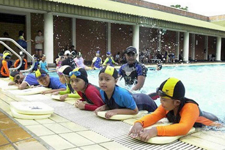 Children attending swimming lessons at Cobia Swimming School (CSS). Swim schools are seeing a spike in enquiries from potential students since Schooling's win.