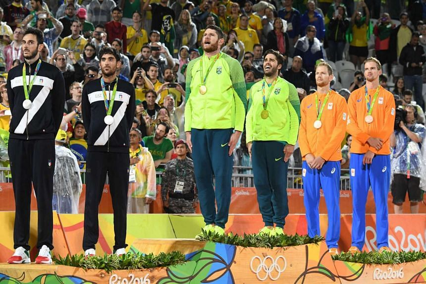 Brazil's gold medallists Alison Cerutti and Bruno Oscar Schmidt on the podium at the end of the men's beach volleyball event at the Beach Volley Arena in Rio de Janeiro on Aug 19, 2016.