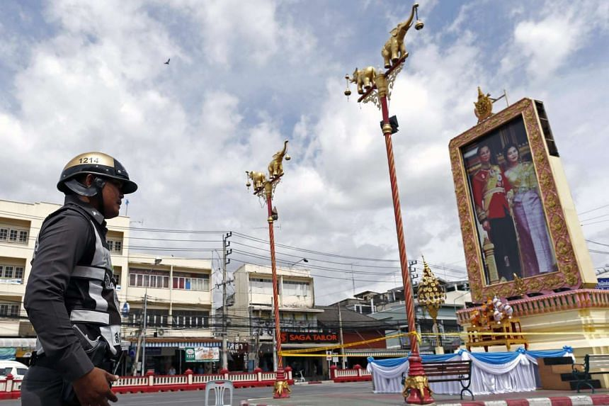 A Thai police officer secures the area after bombs exploded at the clock tower site in the center of Hua Hin city, Thailand, Aug 12, 2016.